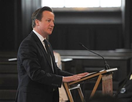 Britain's Prime Minister David Cameron delivers a reading during a service to mark the 20th anniversary of the murder of teenager Stephen Lawrence, at St Martin-in-the-Fields church in London April 22, 2013. REUTERS/Andrew Matthews/Pool