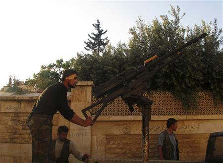 A Free Syrian Army fighter holds onto an anti-aircraft weapon in the Khan al-Assal area, near Aleppo April 27, 2013. REUTERS/Abdalghne Karoof