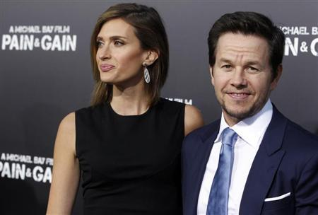 Actor Mark Wahlberg and his wife Rhea Durham arrive at the premiere of his new film ''Pain & Gain'' in Hollywood April 22, 2013. REUTERS/Fred Prouser