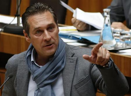 Austrian Freedom Party leader (FPOe) Heinz-Christian Strache delivers his speech in the parliament during a discussion of the Cyprus bail-out in Vienna April 25, 2013. REUTERS/Leonhard Foeger