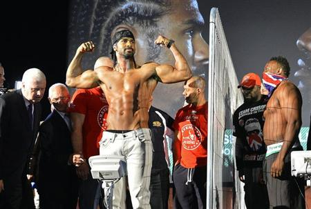 Former WBA world heavyweight champion David Haye (C) poses during his weigh-in as former British & Commonwealth heavyweight champion Dereck Chisora (R) looks on, at a cinema in central London July 12, 2012. (file photo) REUTERS/Toby Melville