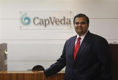 Kalpesh Kinariwala, chief executive officer of CapVeda, poses in his office in Mumbai March 22, 2013. Local hedge funds are eager to show off double-digit returns in the hopes of drawing wealthy Indians and succeeding where overseas players have failed. Local market knowledge and the lack of foreign currency exposure will favour domestic funds, but it remains to be seen whether Indians would embrace new investment styles in a country that traditionally prefers buying and holding stocks. Picture taken March 22, 2013. REUTERS/Danish Siddiqui