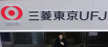 A woman walks out from a branch of Mitsubishi UFJ Financial Group (MUFG) in Tokyo November 14, 2012. REUTERS/Yuriko Nakao