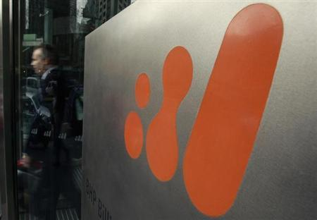 A man walks out of the head office of BHP Billiton in central Melbourne August 18, 2010. REUTERS/Mick Tsikas