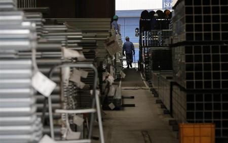 A worker walks at a factory in Urayasu, near Tokyo March 29, 2013. REUTERS/Toru Hanai
