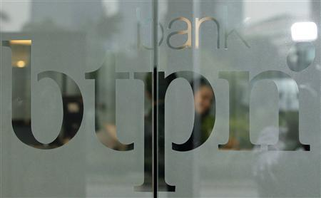 The logo of Bank Tabungan Pensiunan Nasional Tbk PT (BTPN) is seen at the bank's headquarters in Jakarta, in this file picture taken May 11, 2011. REUTERS/Enny Nuraheni/Files