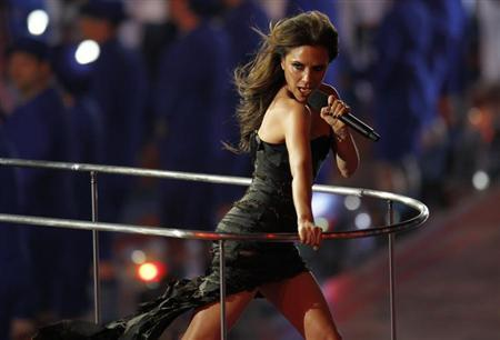 Victoria Beckham performs with The Spice Girls during the closing ceremony of the London 2012 Olympic Games at the Olympic Stadium, August 12, 2012. REUTERS/Gary Hershorn/Files