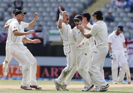 New Zealand's Neil Wagner (C) celebrates dismissing England's Ian Bell with Peter Fulton (L), Kane Williamson (2nd R) and Dean Brownlie (R) on day five of their final cricket test at Eden Park in Auckland, March 26, 2013. REUTERS/Nigel Marple/Files