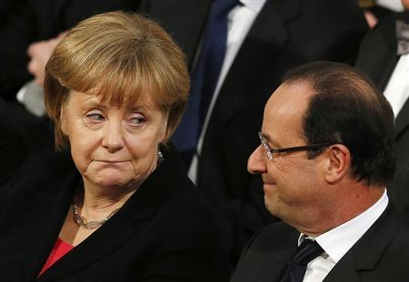 German Chancellor Angela Merkel (L) and President of France Francois Hollande exchange glances during the Nobel Peace Prize ceremony at City Hall in Oslo December 10, 2012. REUTERS/Suzanne Plunkett