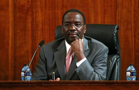 Kenya's Chief Justice Willy Mutunga follows proceedings during the mention of the Presidential poll petition at the Supreme Court in Kenya's capital Nairobi, March 20, 2013. REUTERS/Thomas Mukoya