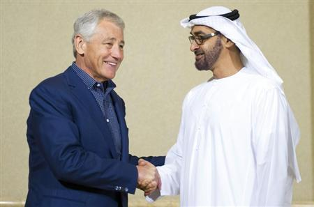 U.S. Secretary of Defense Chuck Hagel (L) greets Abu Dhabi Crown Prince Mohammed Bin Zayed Al-Nahyan during a meeting in Abu Dhabi April 25, 2013. REUTERS/Jim Watson/Pool