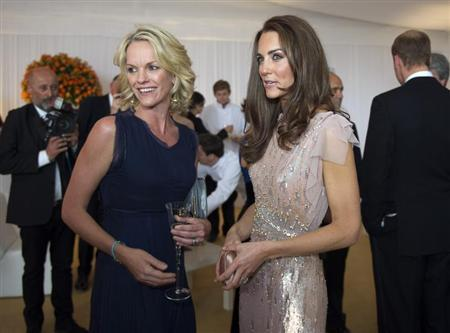 Britain's Catherine, Duchess of Cambridge speaks with Elizabeth Murdoch at the 10th annual ARK (Absolute Return for Kids) gala dinner at Kensington Palace in London June 9, 2011. REUTERS/Arthur Edwards/pool