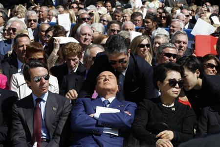 Former Italian Prime Minister Silvio Berlusconi (C ) is pictured as a translator repeats remarks by former U.S. president George W. Bush (not pictured) at the dedication ceremony of the George W. Bush Presidential Center in Dallas, April 25, 2013. REUTERS/Jason Reed