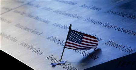 An American flag is seen left in the plaque of names on the edge of the North Pool of the 9/11 Memorial during ceremonies marking the 11th anniversary of the 9/11 attacks on the World Trade Center in New York, September 11 2012. REUTERS/Mike Segar/Files
