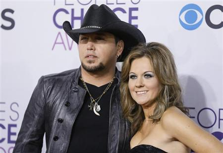 Country music star Jason Aldean and his wife Jessica arrive at the 2013 People's Choice Awards in Los Angeles, January 9, 2013. REUTERS/Danny Moloshok