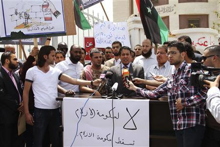 Adel Al-Ghiryani (C), spokesperson of the Supreme Council of Libyan Revolutionaries, speaks to the media in Tripoli April 28, 2013. REUTERS/Stringer