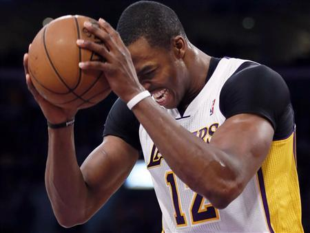 Los Angeles Lakers center Dwight Howard (12) reacts after being fouled by the San Antonio Spurs during Game 4 of their NBA Western Conference Quarterfinals basketball playoff series in Los Angeles, April 28, 2013. REUTERS/Lucy Nicholson