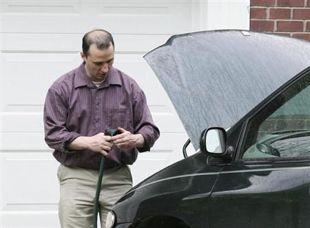 Everett Dutschke works on his mini-van in his driveway in Tupelo Mississippi on April 26, 2013. Federal agents arrested Dutschke on Saturday after his home and a former business were searched as part of an investigation into ricin-laced letters sent to President Barack Obama and two other public officials. Picture taken on April 26, 2013. REUTERS/Thomas Wells