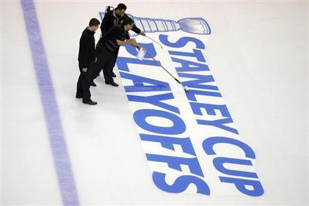 Crews prepare the ice for the start of the Stanley Cup Playoffs following the NHL hockey game between the Boston Bruins and the Ottawa Senators in Boston, Massachusetts April 28, 2013. REUTERS/Brian Snyder