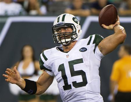New York Jets quarterback Tim Tebow passes against the Carolina Panthers in the fourth quarter of their pre-season NFL football game in East Rutherford, New Jersey in this file photo taken August 26, 2012. REUTERS/Ray Stubblebine/Files