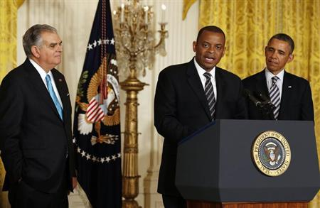 U.S. President Barack Obama (R) listens to Charlotte, N.C., Mayor Anthony Foxx (C) after naming him to replace Ray LaHood (L) as U.S. Transportation Secretary in the East Room of the White House in Washington, April 29, 2013. REUTERS/Larry Downing