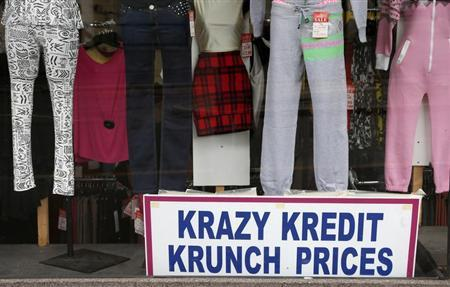A discount notice is seen in the window of a clothes shop in Hanley, Stoke on Trent, central England April 24, 2013. REUTERS/Phil Noble