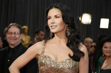 Actress Catherine Zeta-Jones, wearing a Zuhair Murad gown and Lorraine Schwartz jewels, arrives at the 85th Academy Awards in Hollywood, California February 24, 2013. REUTERS/Lucy Nicholson