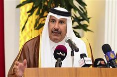 Qatar's Prime Minister and Foreign Minister Sheik Hamad bin Jassim Al Thani speaks during a news conference with Egypt's Prime Minister Hisham Kandil (not pictured) at Diwam Emir in Doha, April 10, 2013. REUTERS/Stringer