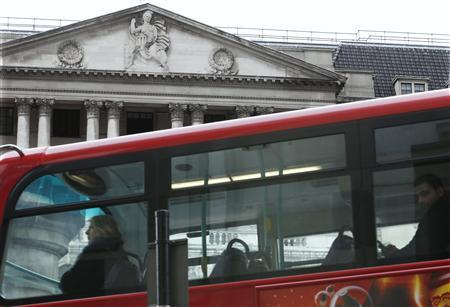 A bus drives past the Bank of England in the City of London March 15, 2013. REUTERS/Suzanne Plunkett