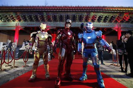 Performers pose for a photo during a promotional event of the movie 'Iron Man 3' before its release in China at the Imperial Ancestral Temple of Beijing's Forbidden City, in this April 6, 2013 file picture. REUTERS/Jason Lee/Files