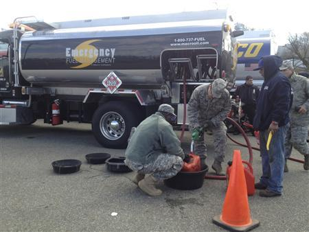 Tanker trucks distribute fuel to residents who were affected by Hurricane Sandy in Staten Island, New York, in this handout photo taken by FEMA on November 3, 2012. REUTERS/Walt Jennings/FEMA/Handout