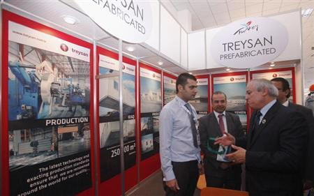 Libyan Oil Minister Abdelbari al-Arusi (R) visits a company stand as part of an exhibition for the Libya Oil and Gas Summit 2013 in Tripoli April 22, 2013. REUTERS/Ismail Zitouny