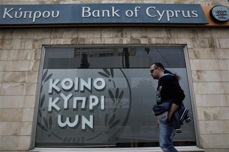 A man walks past a branch of Bank of Cyprus in Nicosia March 31, 2013. REUTERS/Yorgos Karahalis