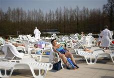 A woman enjoys the sun at the thermal water spa in Hungarian town of Heviz, 194 km (120 miles) west of Budapest, April 20, 2013. REUTERS/Bernadett Szabo
