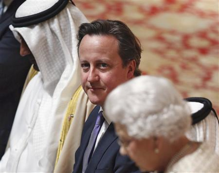 Britain's Prime Minister David Cameron (C) listens to Queen Elizabeth deliver a speech at a State Luncheon for United Arab Emirates President Sheikh Khalifa bin Zayed al-Nahayan (not pictured) in Windsor Castle in Windsor, England April 30, 2013. REUTERS/Oli Scarff/POOL