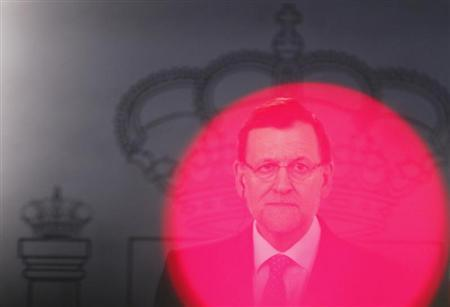 Spain's Prime Minister Mariano Rajoy attends a news conference after a meeting with Slovakia's Prime Minister Robert Fico (not pictured) at Moncloa Palace in Madrid April 23, 2013. REUTERS/Juan Medina