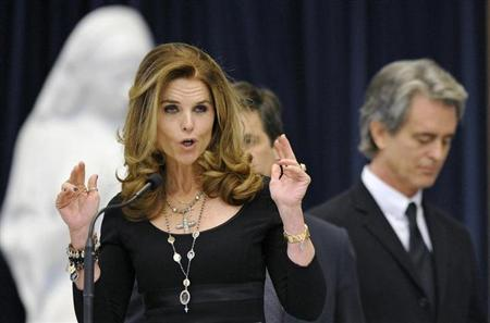 Maria Shriver eulogizes her father, Sargent Shriver, as her brother Robert ''Bobby'' Shriver III (R) listens during his funeral Mass at Our Lady of Mercy Parish Catholic church in Potomac, Maryland January 22, 2011. REUTERS/Cliff Owen/Pool/Files