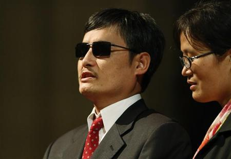 Blind Chinese activist Chen Guangcheng (L), accompanied by his wife Yuan Weijing, addresses the Ignatius Program at the National Cathedral in Washington, January 30, 2013. REUTERS/Jonathan Ernst/Files