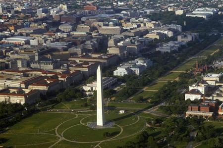 The Washington Monument and surrounding office buildings are seen in an aerial view in this file photo taken May 19, 2011. REUTERS/Jim Bourg/Files