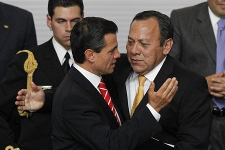 Jesus Zambrano (R), chairman of the Party of the Democratic Revolution (PRD), hugs Mexico's President Enrique Pena Nieto during the presentation of a telecommunications reform bill in Mexico City March 11, 2013. REUTERS/Edgard Garrido