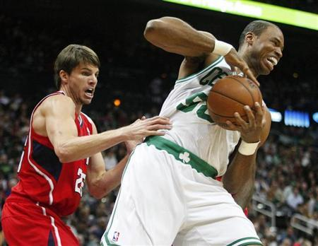 Boston Celtics center Jason Collins (R), grabs a rebound away from Atlanta Hawks guard Kyle Korver in the first half of their NBA basketball game in Atlanta, Georgia January 5, 2013. REUTERS/Tami Chappell