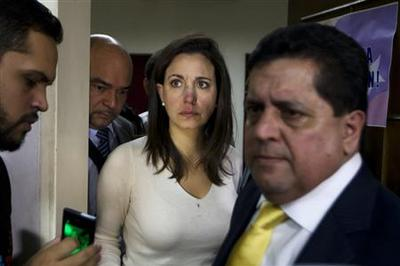 Venezuelan lawmakers hurt during punch-up in parliamen...