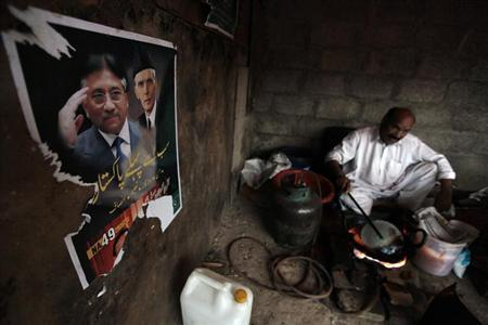 A poster of former President and head of the All Pakistan Muslim League (APML) political party Pervez Musharraf (L), with Muhammad Ali Jinnah, founder and first governor-general of Pakistan, is pictured on a wall as a man prepares snacks in Islamabad April 30, 2013. REUTERS/Faisal Mahmood