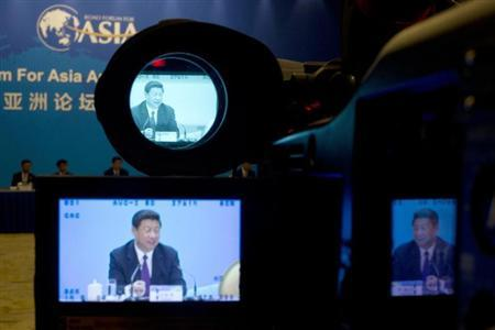 Chinese President Xi Jinping is seen on screens of a TV camera during his meeting with representatives of entrepreneurs at the annual Boao Forum in Boao, in southern China's Hainan province April 8, 2013. REUTERS/Alexander F. Yuan/Pool