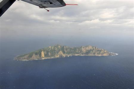 A handout photograph taken on a marine surveillance plane B-3837 shows the disputed islets, known as Senkaku in Japan and Diaoyu in China, December 13, 2012. REUTERS/State Oceanic Administration of People's Republic of China/Handout