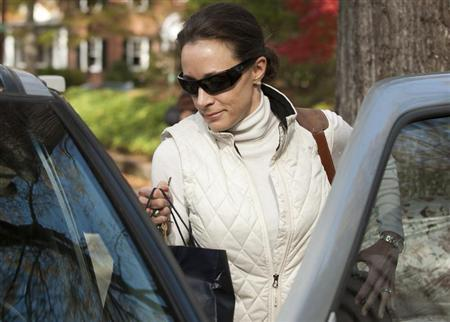 Paula Broadwell, the woman whose affair with CIA director David Petraeus led to his resignation, leaves her home in Charlotte, North Carolina, November 19, 2012. REUTERS/Davis Turner