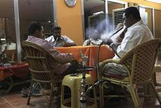 Customers play domino as they smoke waterpipes at a Shisha cafe in Khartoum April 28, 2013. REUTERS/Mohamed Nureldin Abdallah