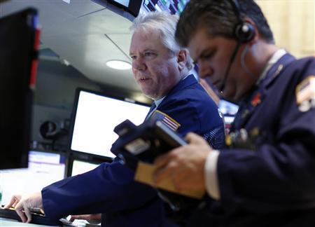 Traders work on the floor at the New York Stock Exchange, April 29, 2013. REUTERS/Brendan McDermid