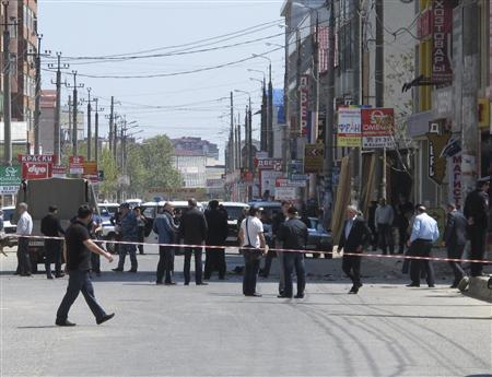 Investigators work at the site of an explosion in Dagestan's capital Makhachkala May 1, 2013. REUTERS/Suleyman Aliev/NewsTeam/Handout