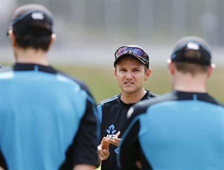 New Zealand's coach Mike Hesson talks to his players ahead of the final cricket test against England in Auckland, March 20, 2013. REUTERS/Nigel Marple/Files